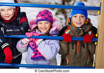 Happiness - Happy kids in winterwear looking at camera...