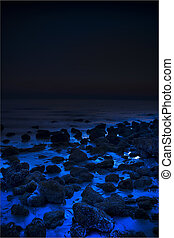 Unknown - Bluish beach rocks with blackened horizon.