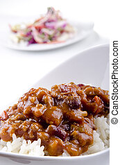 Chilli con carne with basmati rice and some salad in the...