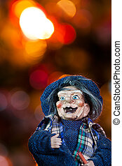 epiphany - closeup of old hag toy with lights christmas tree...