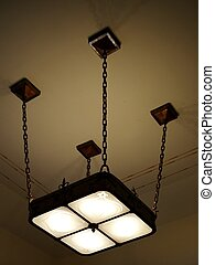OVERHEAD LIGHT FIXTURE - An overhead light fixture with four...