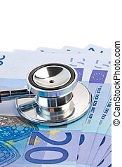 stethoscope on 20-euro banknotes - detail of stethoscope on...