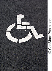 Handicap parking symbol - A white handicap parking symbol is...