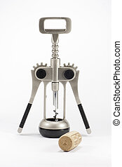 corkscrew - a metal wine opener and next to a cork from a...