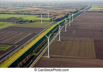 Dutch farmland with windmills - Aerial view of Dutch...