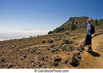 Boy in volcanic landscape at La Palma, Canary Islands