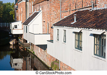 Historic old Dutch city with wooden house extensions above the canal