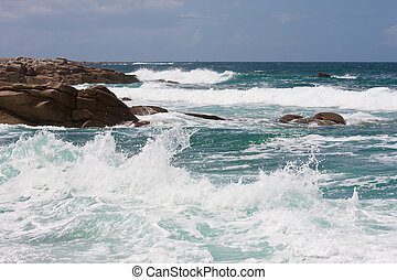 Waves breaking at rocky coast of Brittany