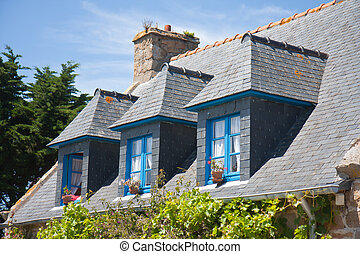 Breton house with typical dormers and shutters, France -...