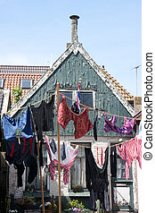 Wash hanging in front of an ancient house, the Netherlands -...