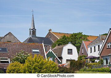 Skyline of Urk, an old fishing village, the Netherlands -...