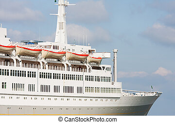 Luxury white cruise ship on a clear day with blue sky -...