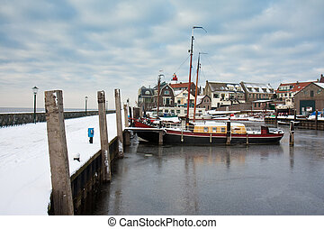 Harbor of Dutch fishery village Urk in wintertime