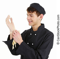 Chef with gloves - A chef putting on gloves to prepare food