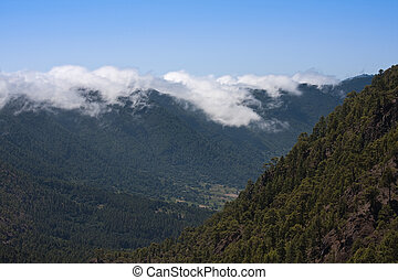 Tumbling clouds over a mountain ridge, La Palma, Canary...