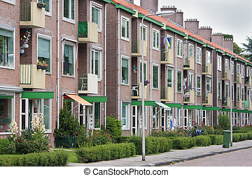 Typical Dutch residential street with flats