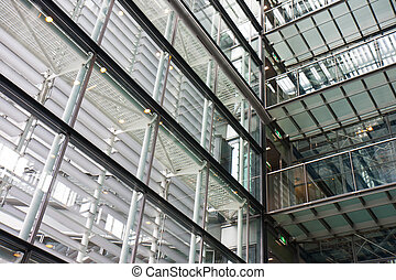 Interior of a modern building with lots of steel and glass