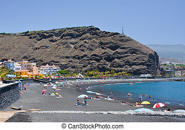 Sunbathing at the beach of Tazacorte, La Palma, Spain