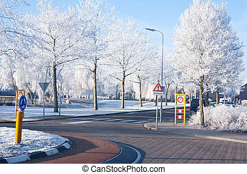 Residential area with traffic circle in wintertime