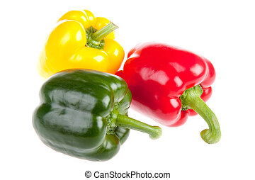 Three red, green and yellow bell peppers isolated on white