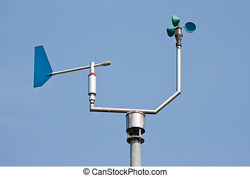 Anemometer measuring wind speed and direction with a blue...