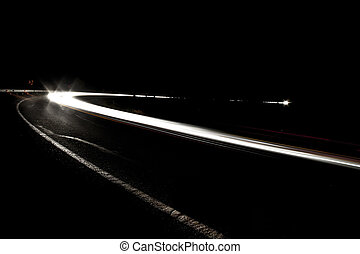 car light on interstate in mountain desert landscape in...