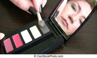 Women applying makeup