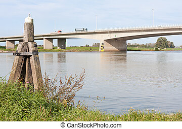 Concrete bridge crossing the river IJssel, the Netherlands,...