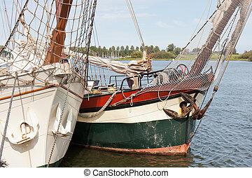 Bow of two old schooners in Dutch harbor Kampen