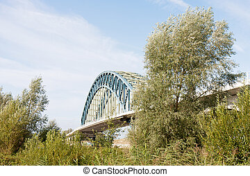 Old iron bridge crossing the river IJssel, the Netherlands