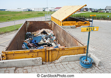 Big iron dumpsters at a refuse dump