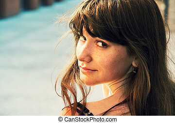 Portrait of a smiling stylish lady - Young cute girl looking...