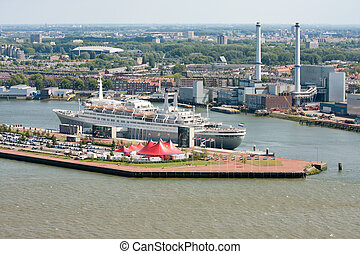 Aerial view of Dutch harbor Rotterdam with a big passenger ship