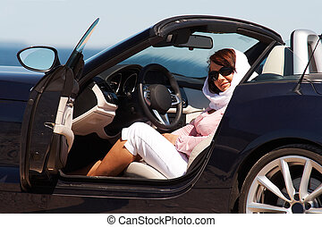 Young lady sitting in cabriolet - Young lady in sunglasses...