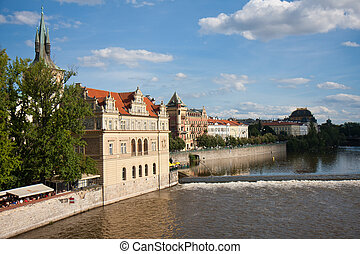 View from the Charles Bridge at the Vltava river embankment and Smetana Museum, Praha, Capital city of the Czech Republic