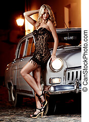 Car - Beautiful lady in black dress standing next to...