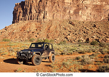 Jeep in Utah's San Juan County Dese - Jeep in a desert...