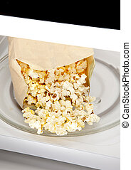 Microwave Popcorn - Popcorn cooked in a microwave oven still...