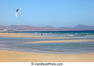 Kitesurfing on the beach on Canary Island Fuerteventura,...