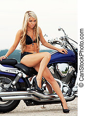 Girl on motorcycle - Young girl in bikini sitting on a...