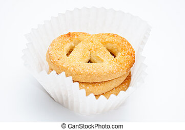 Pretzels in muffin cup over light gray background