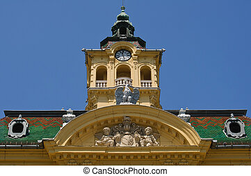 Tower and facade ornaments of town hall in Szeged, Hungary