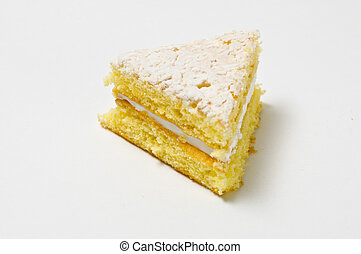 Triangle of sponge cookie with skimming filling isolated on...