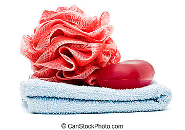 Bath rose and soap bar on top of blue towel isolated on...
