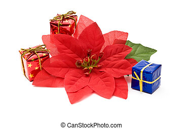 Fake poinsettia with gift boxes isolated on white