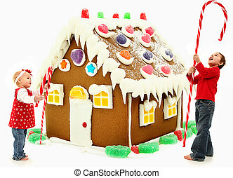 Boy and Girl Children Building Giant Gingerbread House -...