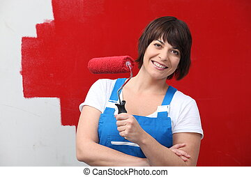 Woman painting wall in red
