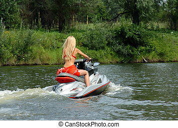 woman in a bathing suit is riding on a boat - beautiful...