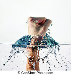 Fist Punching Water - An angry fist punching water isolated...