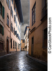 Narrow street in Florence on a rainy day